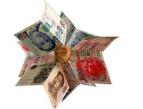 Folded Paper Money. Major asian currencies arranged on a wooden pole stock photography