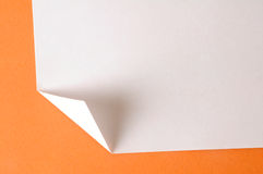 Folded paper. On orange background royalty free stock photography