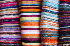 A folded pile of colorful cloth. With different woven patterns Stock Image