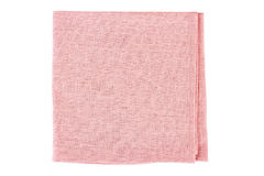 Folded pink textile napkin on white Royalty Free Stock Images