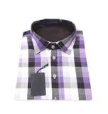 Folded plaid shirt. Royalty Free Stock Photo