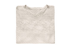Folded pullover isolated. Folded beige lacy pullover isolated over white Royalty Free Stock Image