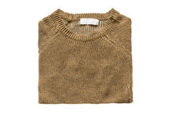 Folded pullover isolated. Bronze colored knitted pullover folded on white background Stock Images