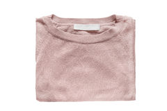 Folded pullover isolated. Elegant pink pullover folded on white background Stock Photo
