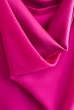 Folded purple fabric Stock Images