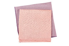 Folded purple and pink textile napkins on white Royalty Free Stock Photo