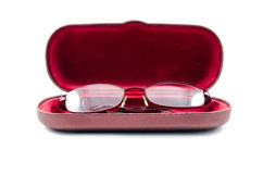 Folded reading glasses inside red case cover Stock Photo