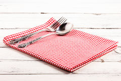 Folded red checkered tablecloth on a white wooden board Royalty Free Stock Photography
