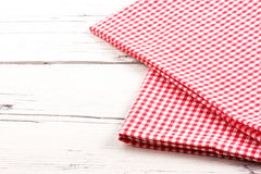 Folded red checkered tablecloth on white wooden board Royalty Free Stock Images