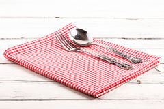 Folded red checkered tablecloth on a white wooden board Royalty Free Stock Photos