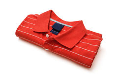 Folded red polo t-shirt on white background Royalty Free Stock Photography