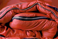 Folded red sleeping bag Stock Photography
