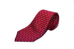 Folded red tie on a white background Royalty Free Stock Photo