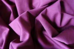 Folded reddish violet viscose stockinette fabric Royalty Free Stock Image