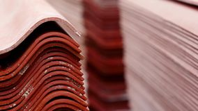 Folded roof tiles. Stock footage. Warehouse materials. Metal sheets profile steel roofing panel construction material stock video
