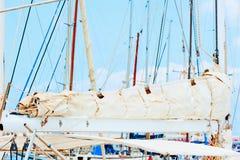 Folded sail boats Stock Photos