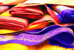 Folded Sarees. A bunch of colorful folded silk sarees Royalty Free Stock Photography