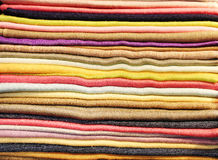 Folded scarfs and fabrics background Royalty Free Stock Image