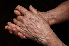 Folded senior woman wrinkled hands close up. Old age, age proble Royalty Free Stock Image