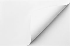 Folded sheet of paper with curled corner. Blank folded sheet of paper with curled corner stock photos