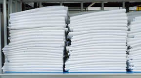 Folded sheets. Clean Folded sheets at a commercial laundry Stock Photo