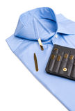 Folded shirt with gold collar stays Stock Photo