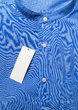 Folded shirt with white tag Royalty Free Stock Photography