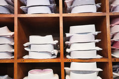 Folded shirts on clothes rack Stock Photos