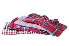 Folded shirts. Isolated on white background royalty free stock photos
