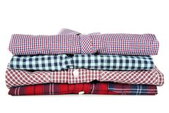 Folded shirts. Stack of folded shirts isolated on white background royalty free stock images