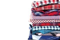 Folded shirts. Stack of folded shirts on white background royalty free stock photography