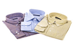 Folded shirts on white Royalty Free Stock Images
