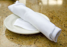 Folded silverware. In a napkin on a plate royalty free stock images