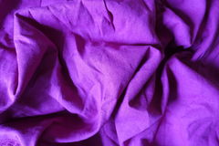 Folded simple bright violet linen fabric Royalty Free Stock Photo
