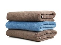 Folded soft terry towels. On white background stock photography