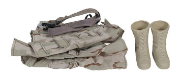 Folded Soldier Clothes with Boots Stock Image