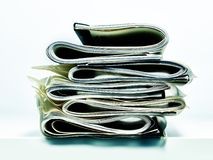 Folded stack of business, legal or insurance papers. Stack of folded business, legal or insurance papers with natural colors resting on edge of desk Stock Images