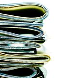 Folded stack of business, legal or insurance papers. Stack of folded business, legal or insurance papers with strong saturated color style Stock Images
