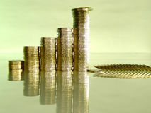 Folded stack of coins in the form of charts. Diagram consisting of piles of coins, denotes financial collapse Royalty Free Stock Photo