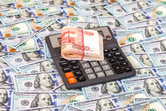 Folded stack of russian roubles and calculator on dollars Stock Images