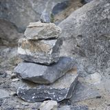 Folded stone pyramid on a stone background. Stones are broken.  Stock Images