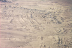 Folded stratigraphy in snow. Aerial view of folded stratigraphy in snow Mongolia Royalty Free Stock Images