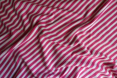 Folded striped fabric in pink and white. From above Royalty Free Stock Image