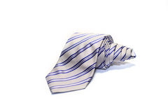 Folded striped necktie on a white background Stock Images