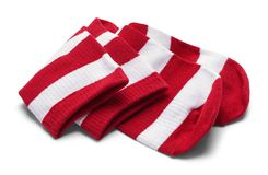 Folded Striped Socks. Two Red and White Striped Folded Socks Isolated on White royalty free stock photos