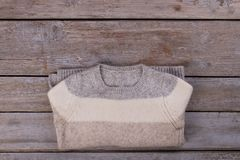 Folded striped woolen sweater Royalty Free Stock Photography
