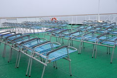 Folded Sunlounger. On a rainy day at a cruising ship Stock Image