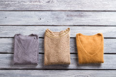 Folded sweaters of different color. Royalty Free Stock Images