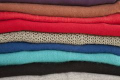 Folded Sweaters in a Pile Stock Photos