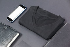 Folded t-shirt, smartphone, diary, card and note pad Royalty Free Stock Photography